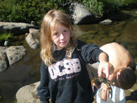 Picture of small girl with crawdad in hand