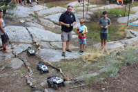 picture of children with remote control toy jeeps